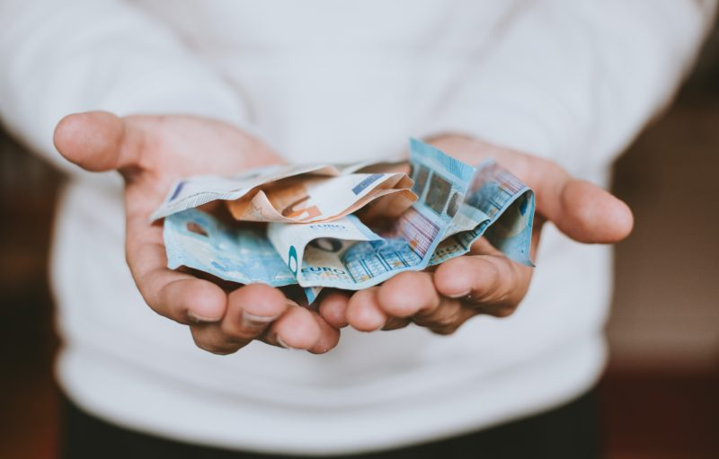 Donation. Photo by Christian Dubovan on Unsplash